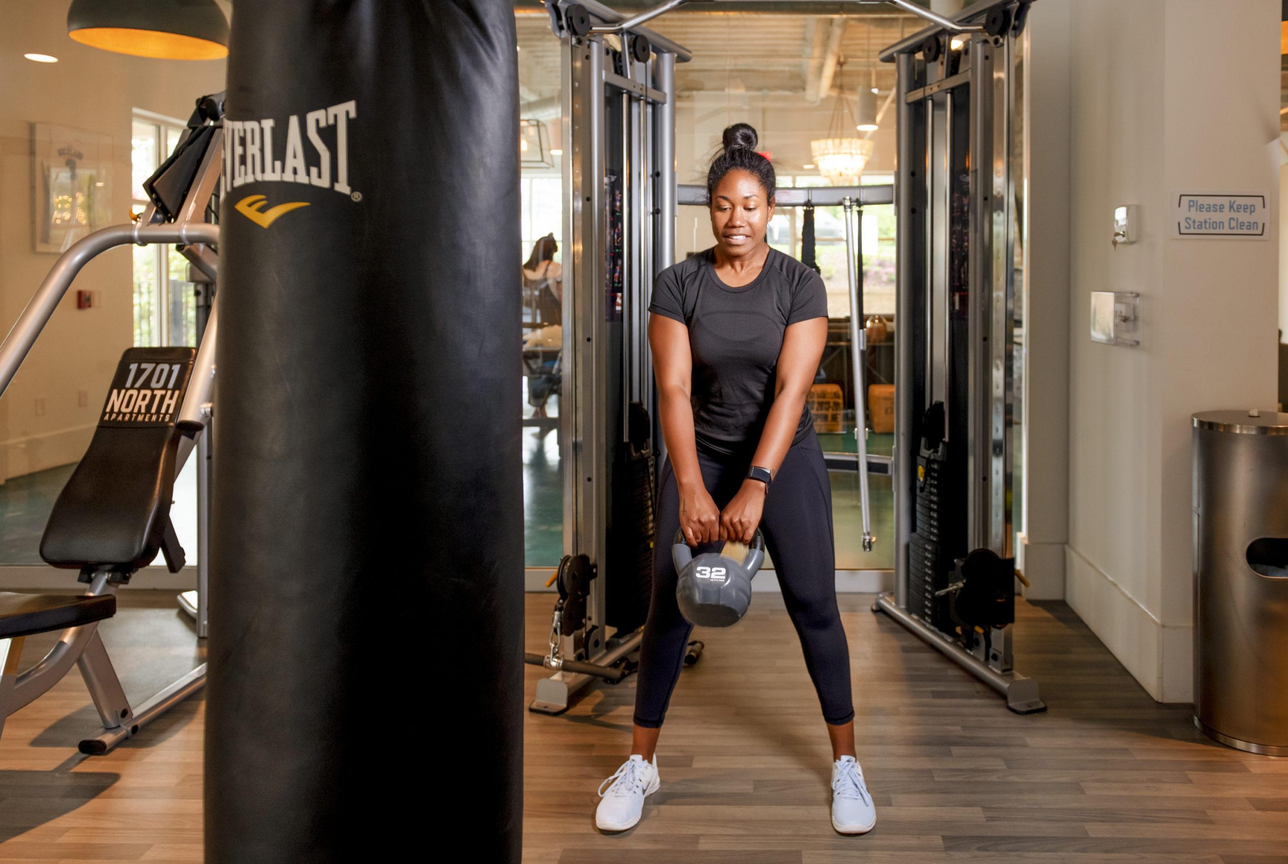girl swinging kettlebell at evolve community new workout