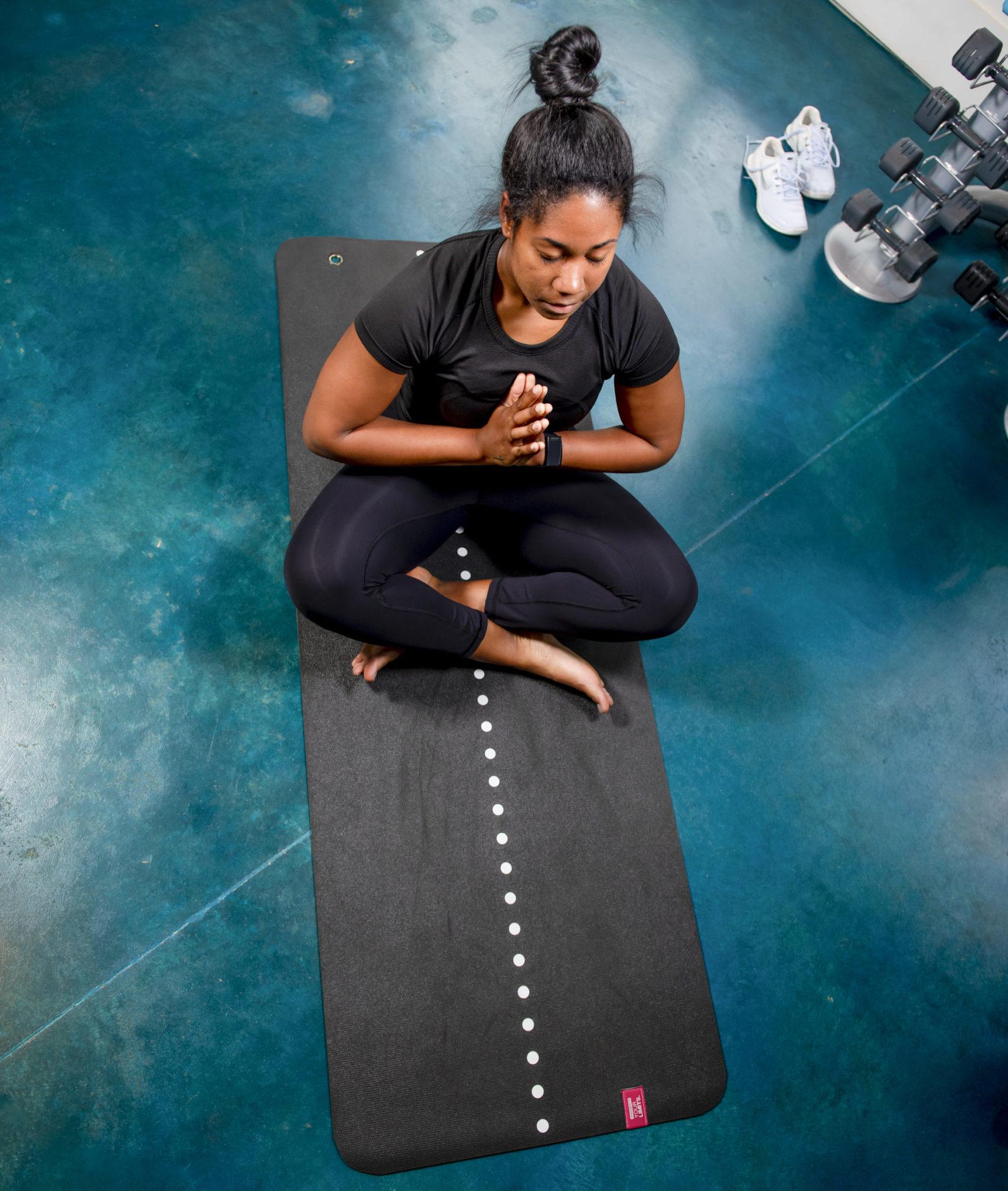 girl meditating at evolve community new workout