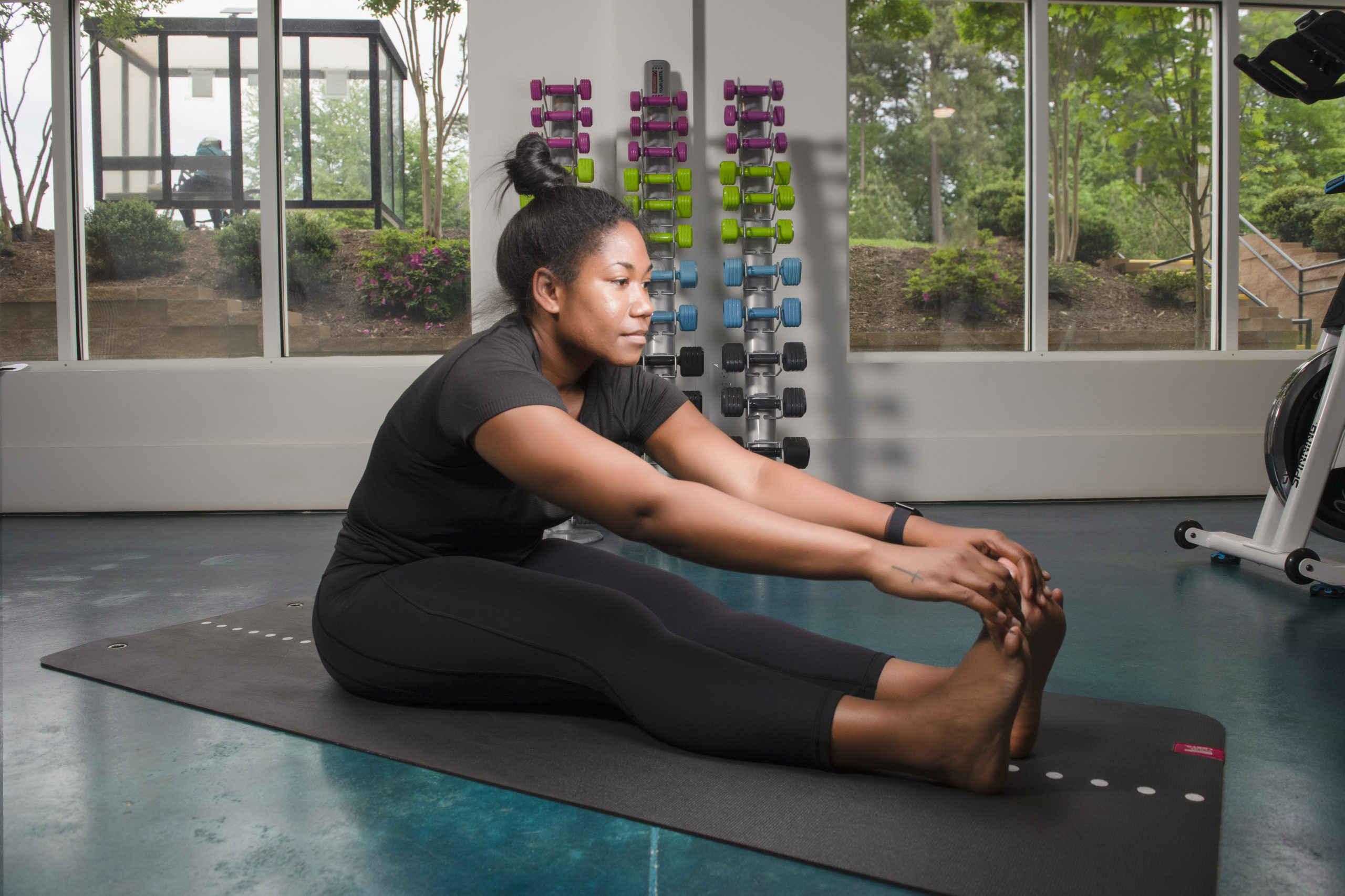 Girl stretching in fitness center during workout at Evolve