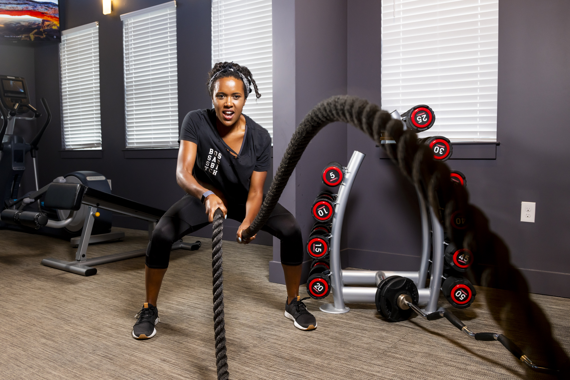 girl with battle ropes at evolve community new workout