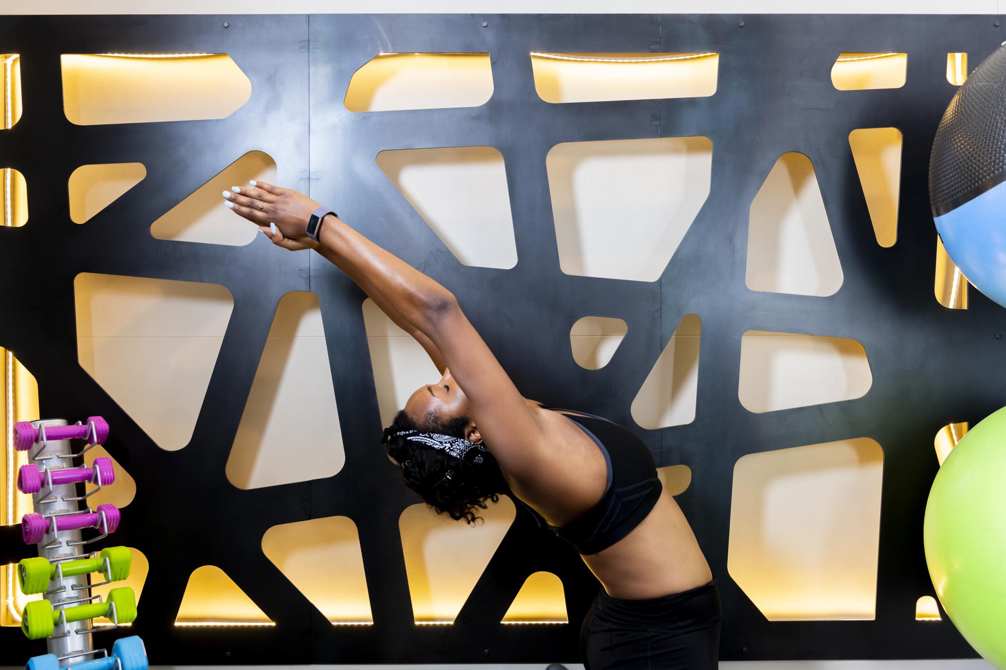 girl doing yoga in evolve fitness center