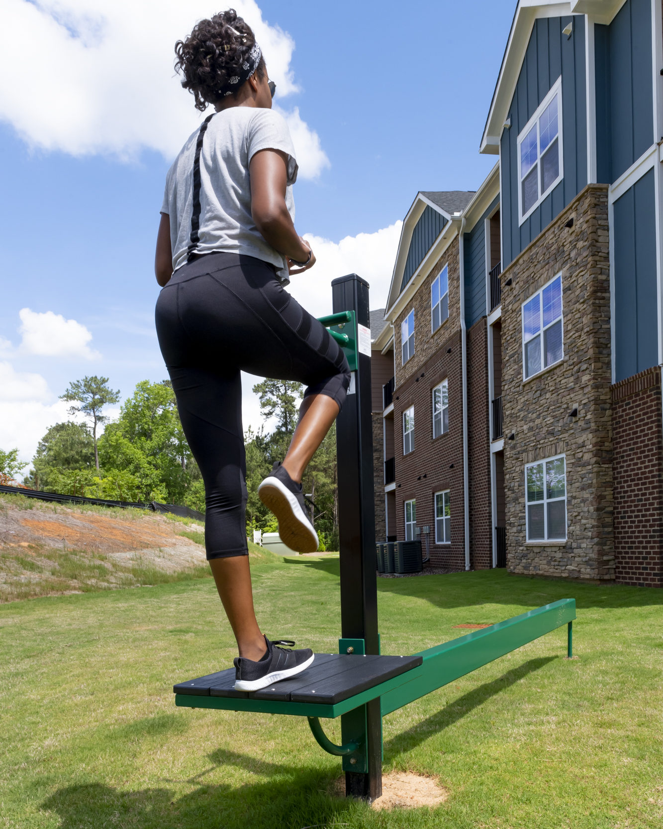 girl working out outside at evolve community new workout