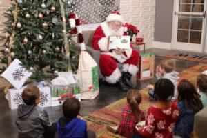 7 nye party decoration ideas santa reading to kids