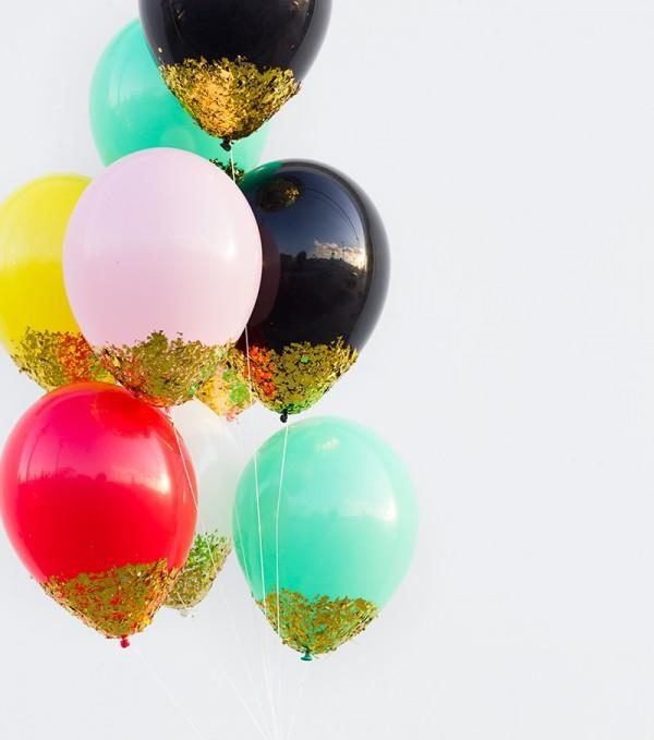 7 nye party decoration ideas confetti dipped balloons