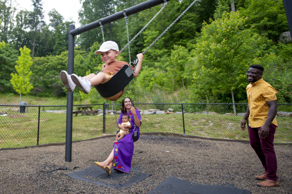 kids on swingset at evolve community playground