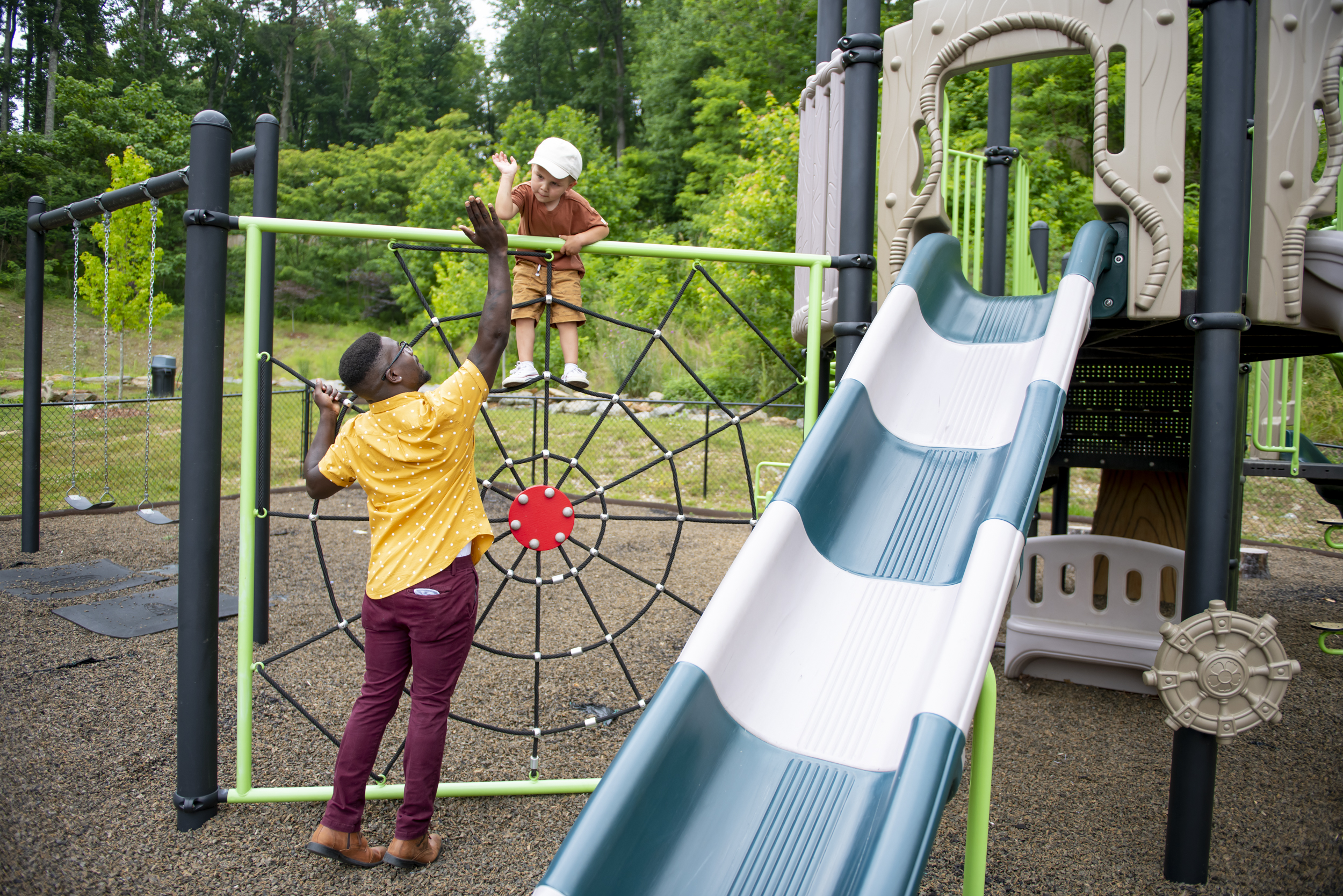 family on playground at evolve community