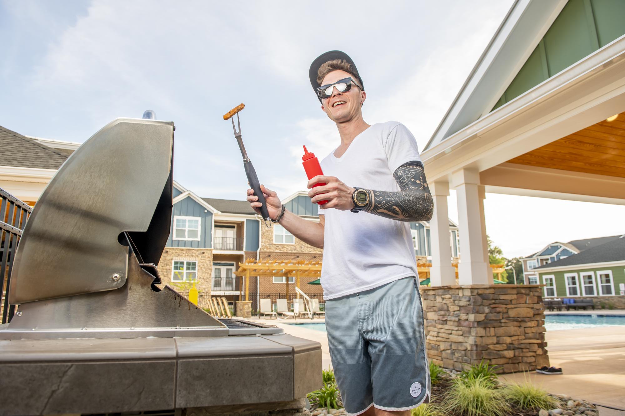 guy grilling hotdogs at evolve summer recipes