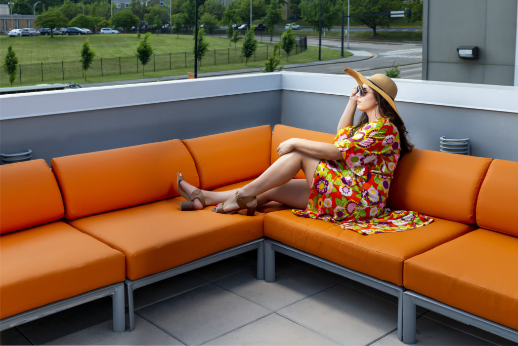 girl on orange couch outdoors at evolve community