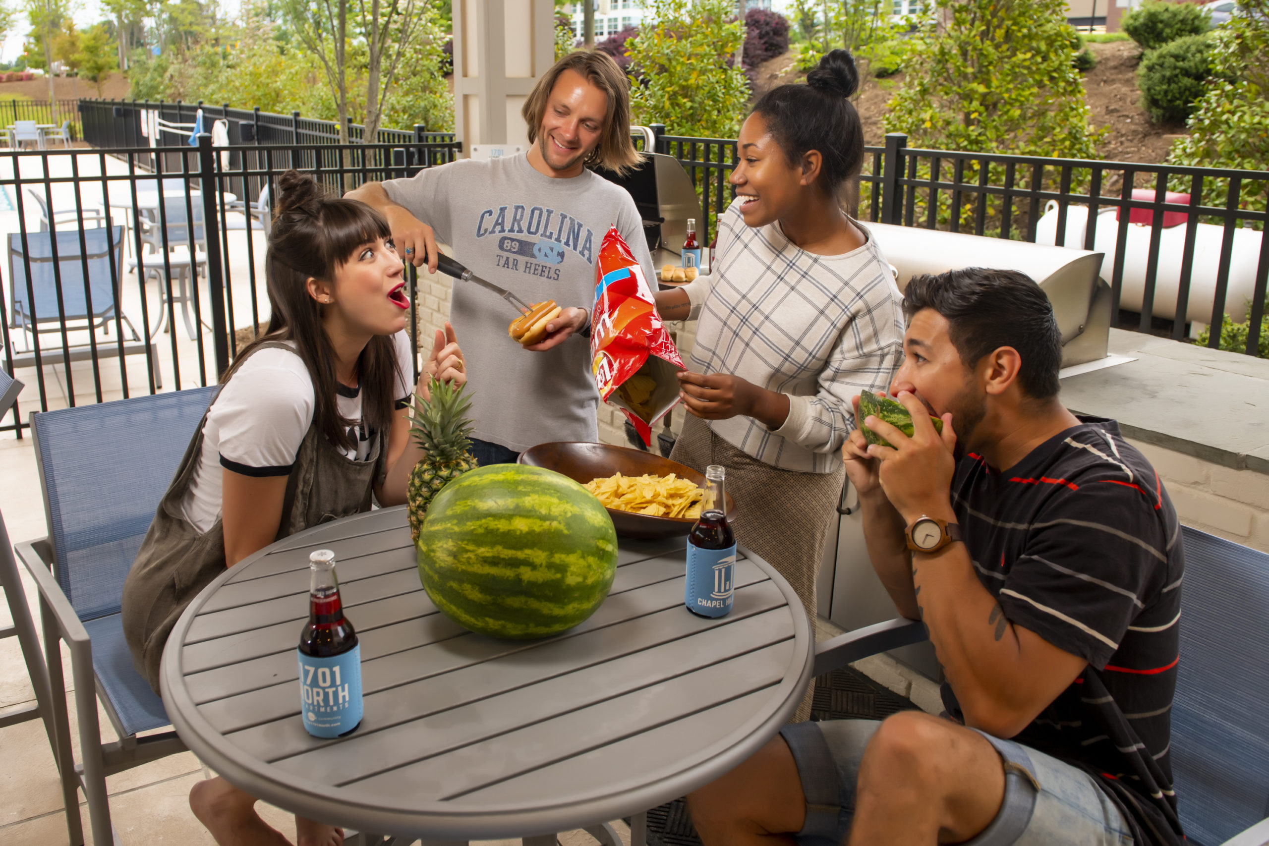people grilling eating chips and dip at evolve summer recipes
