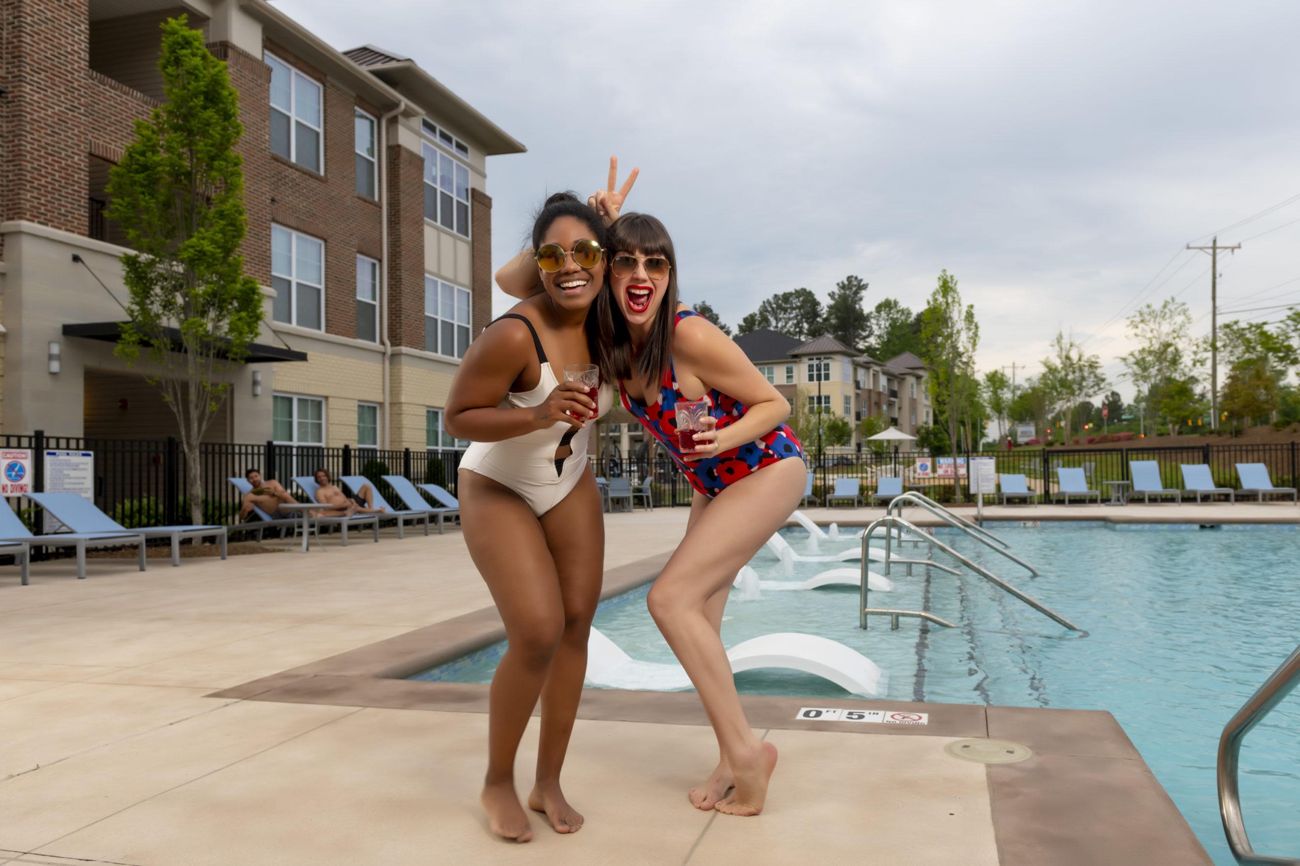 girl friends drinking summer recipe margaritas by pool
