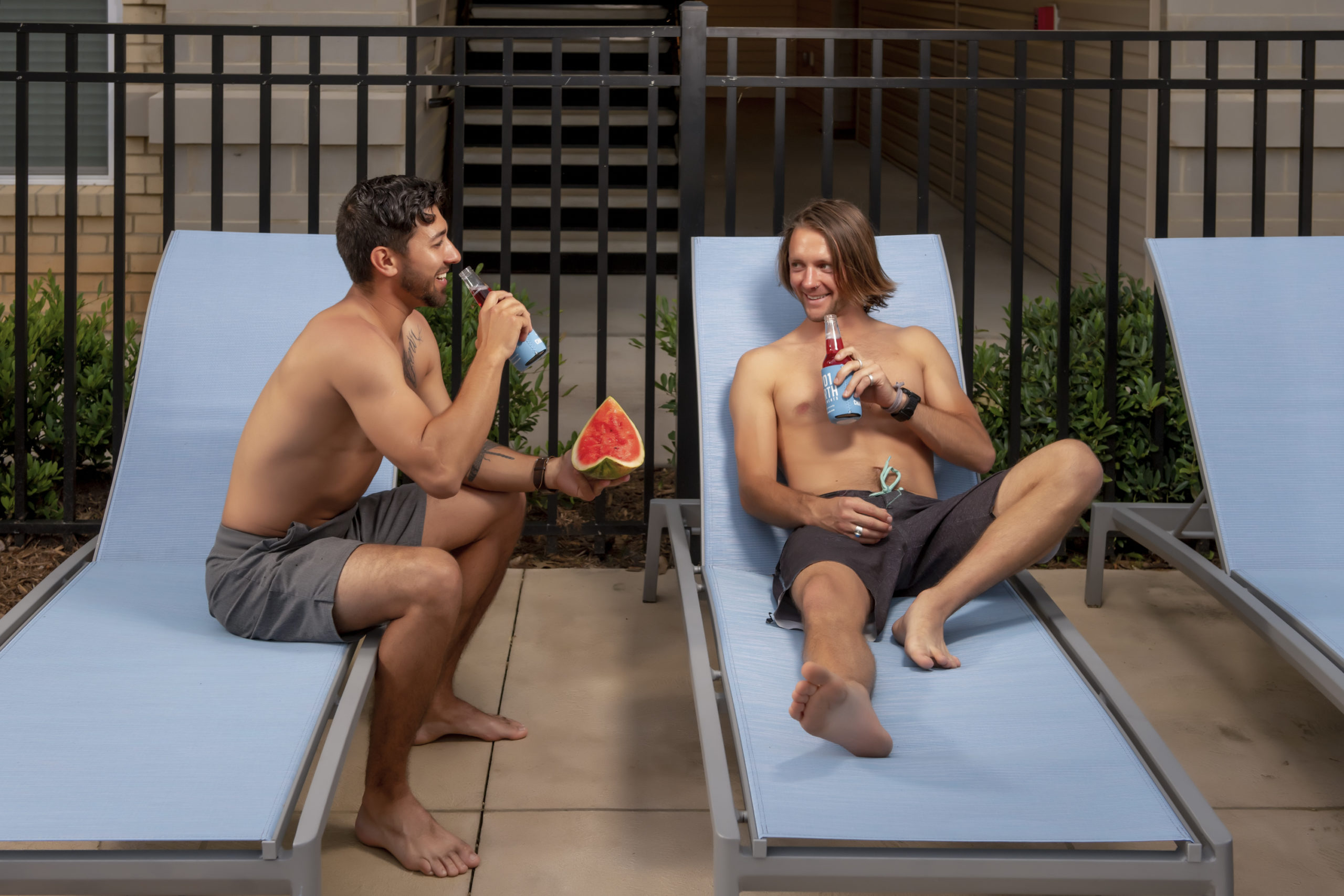 guys with watermelon on pool deck summer recipes evolve