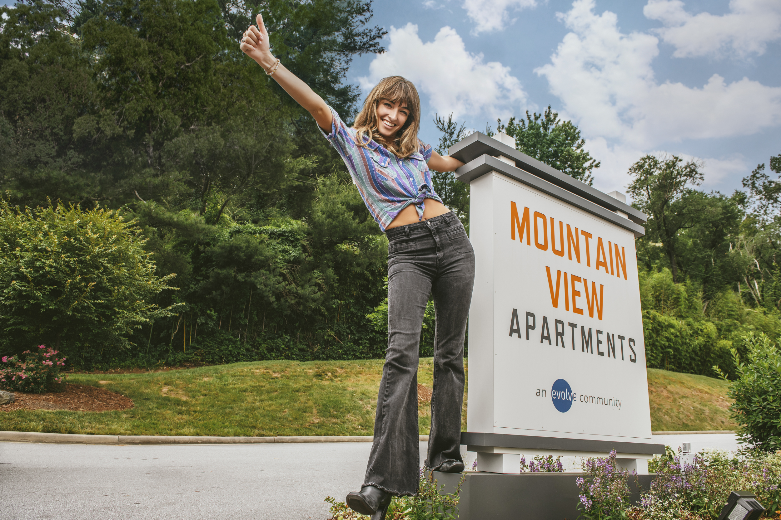 girl standing by sign at mountain view road trip spots