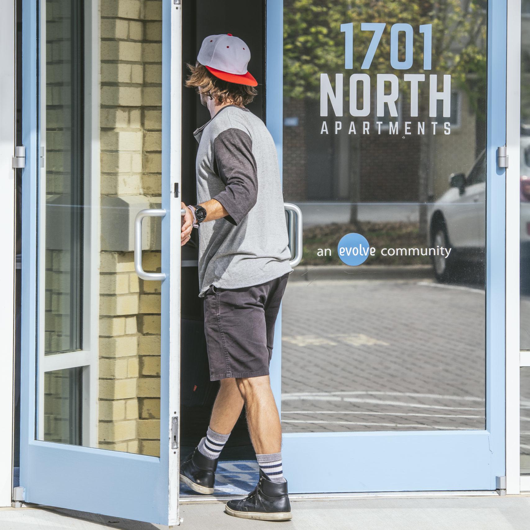 guy walking in door at 1701 north road trip spots