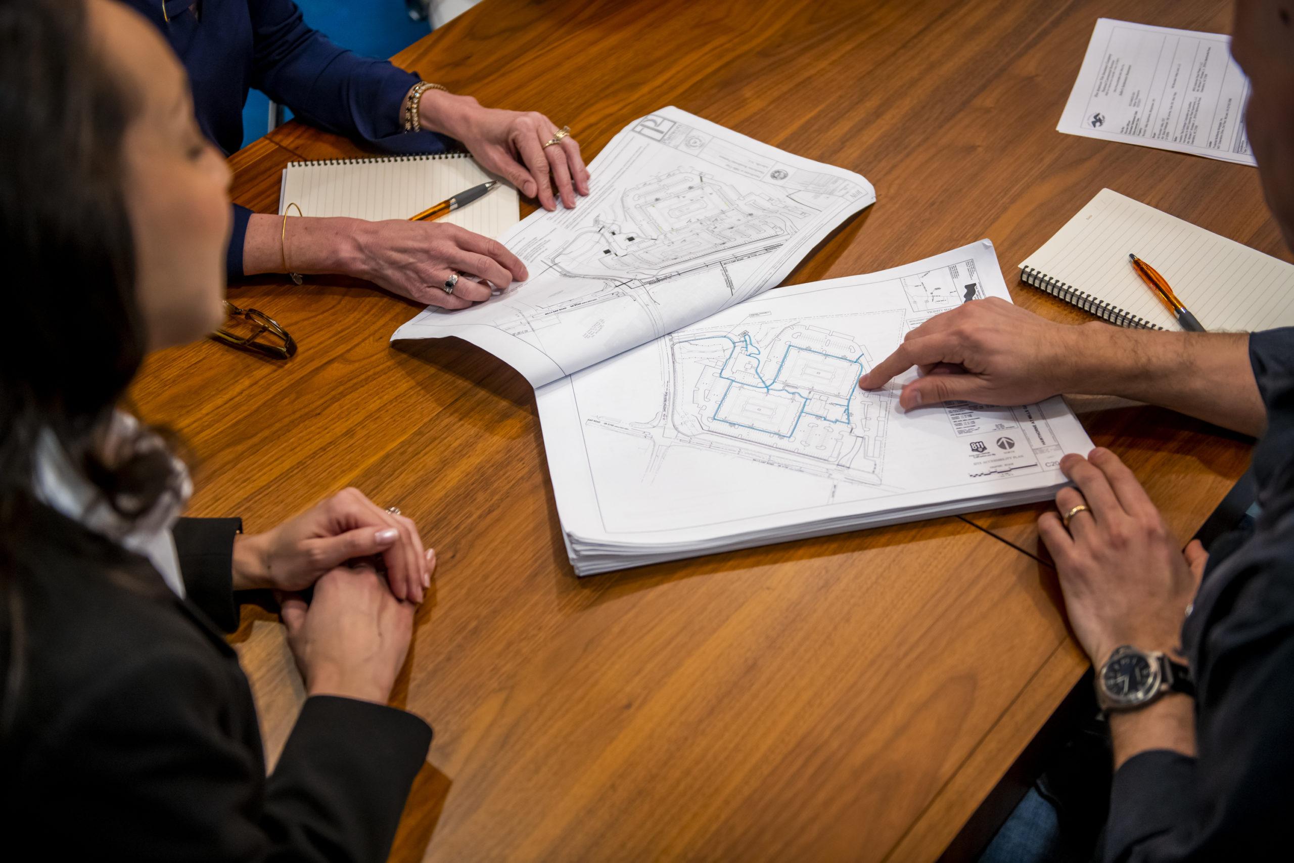 blueprints in conference room how we've evolved 2020