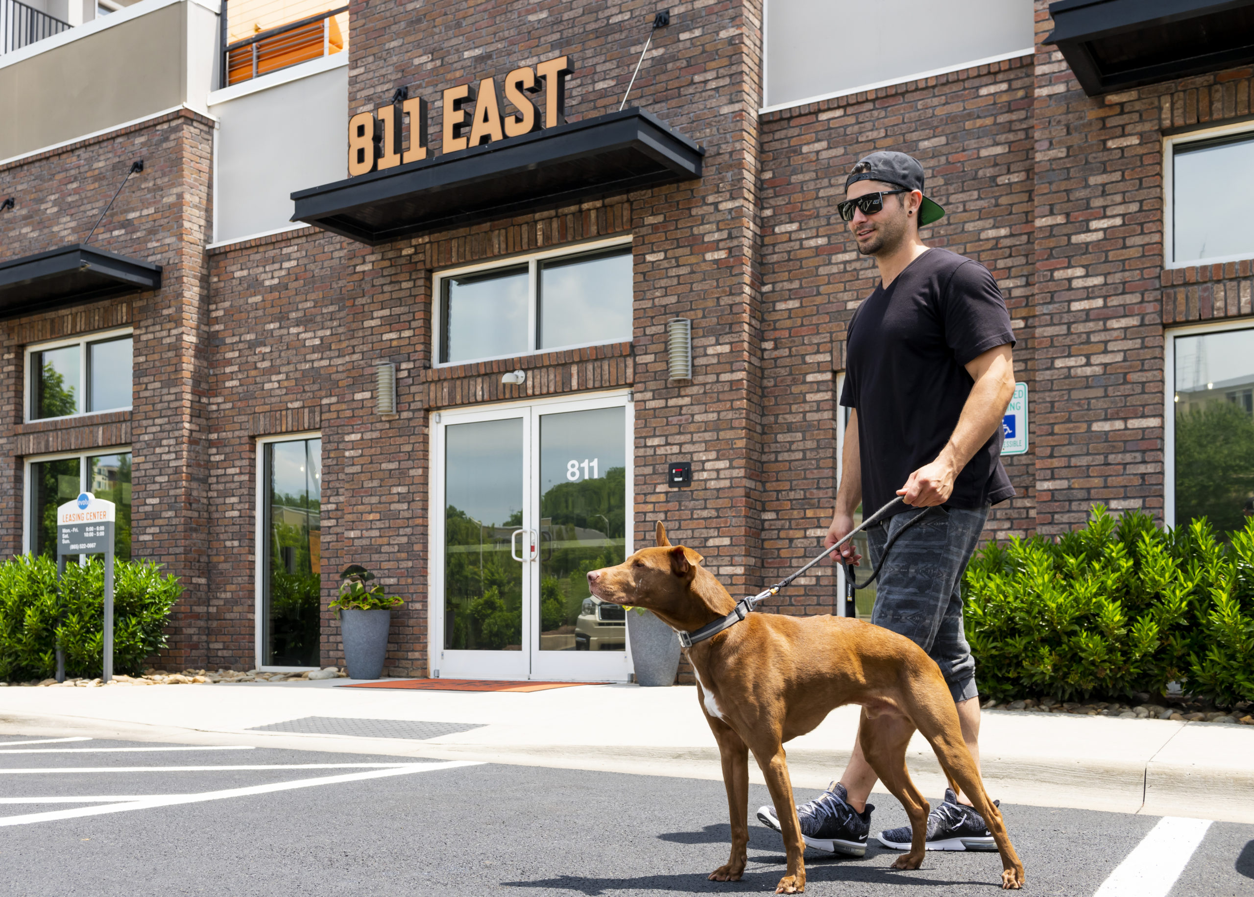 guy with dog outside 811 east road trip spots