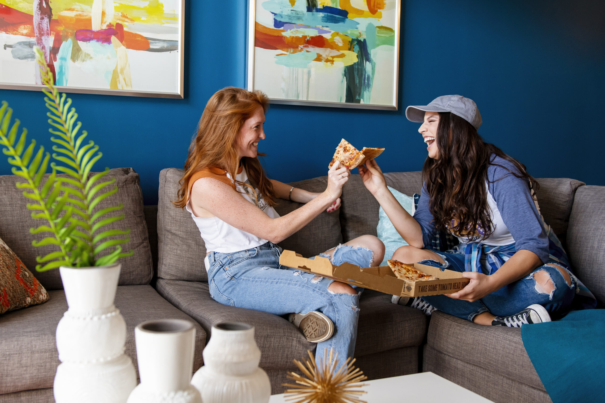 girls eating pizza on couch evolve blog