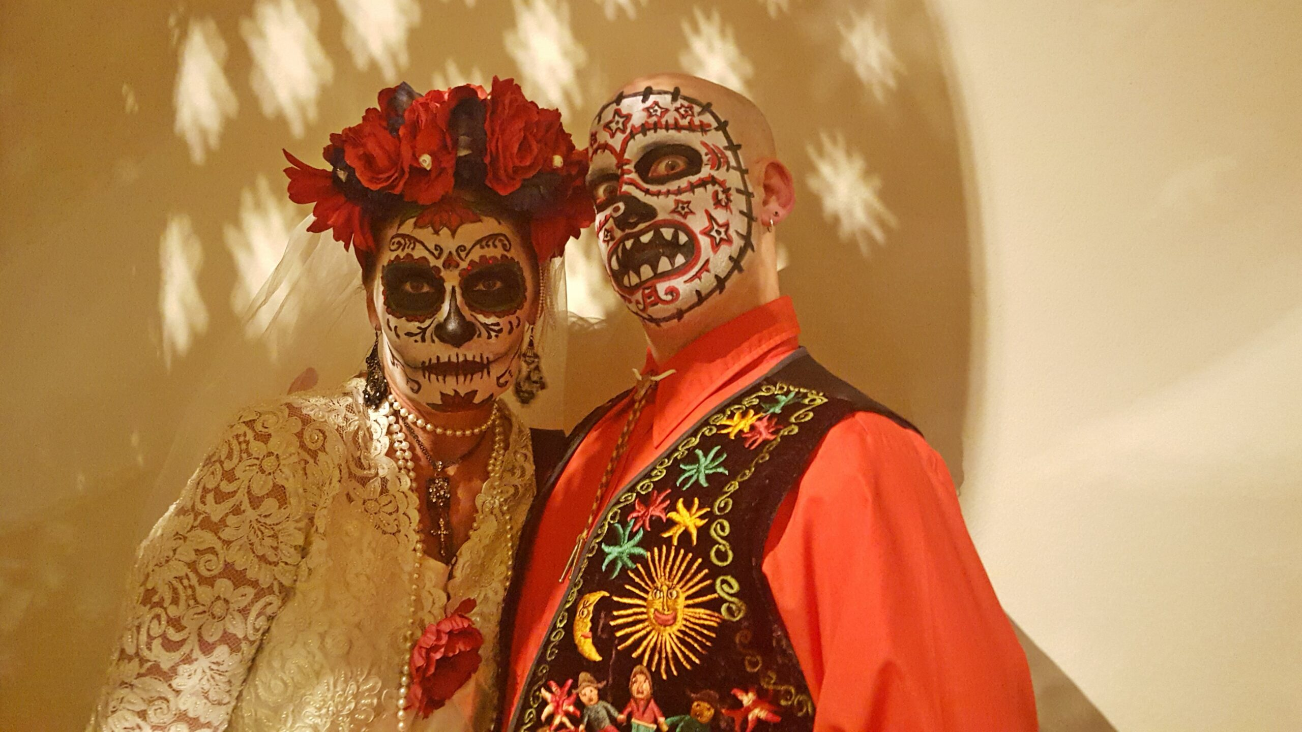 people with sugar skull face paint celebrating halloween evolve blog