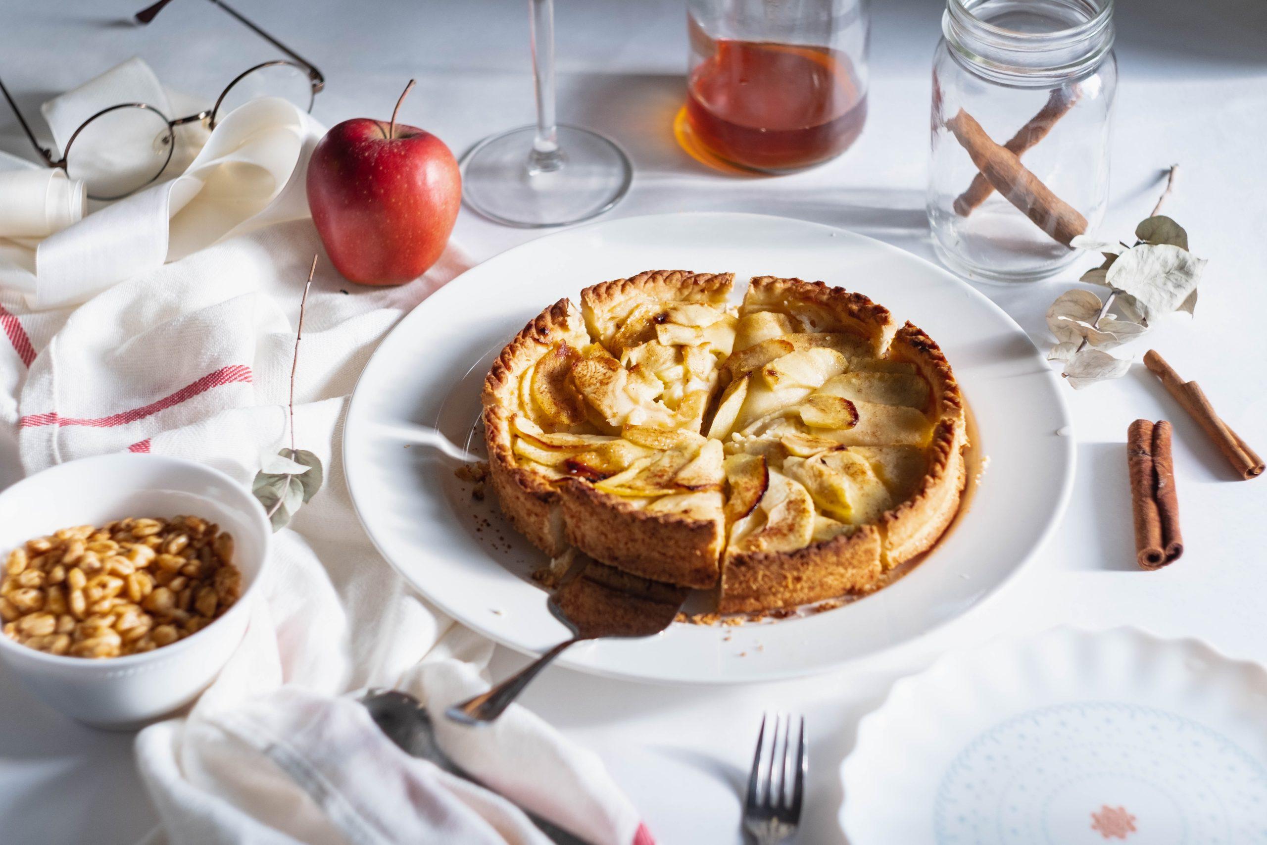 evolve blog apple pie with cinnamon sticks on table
