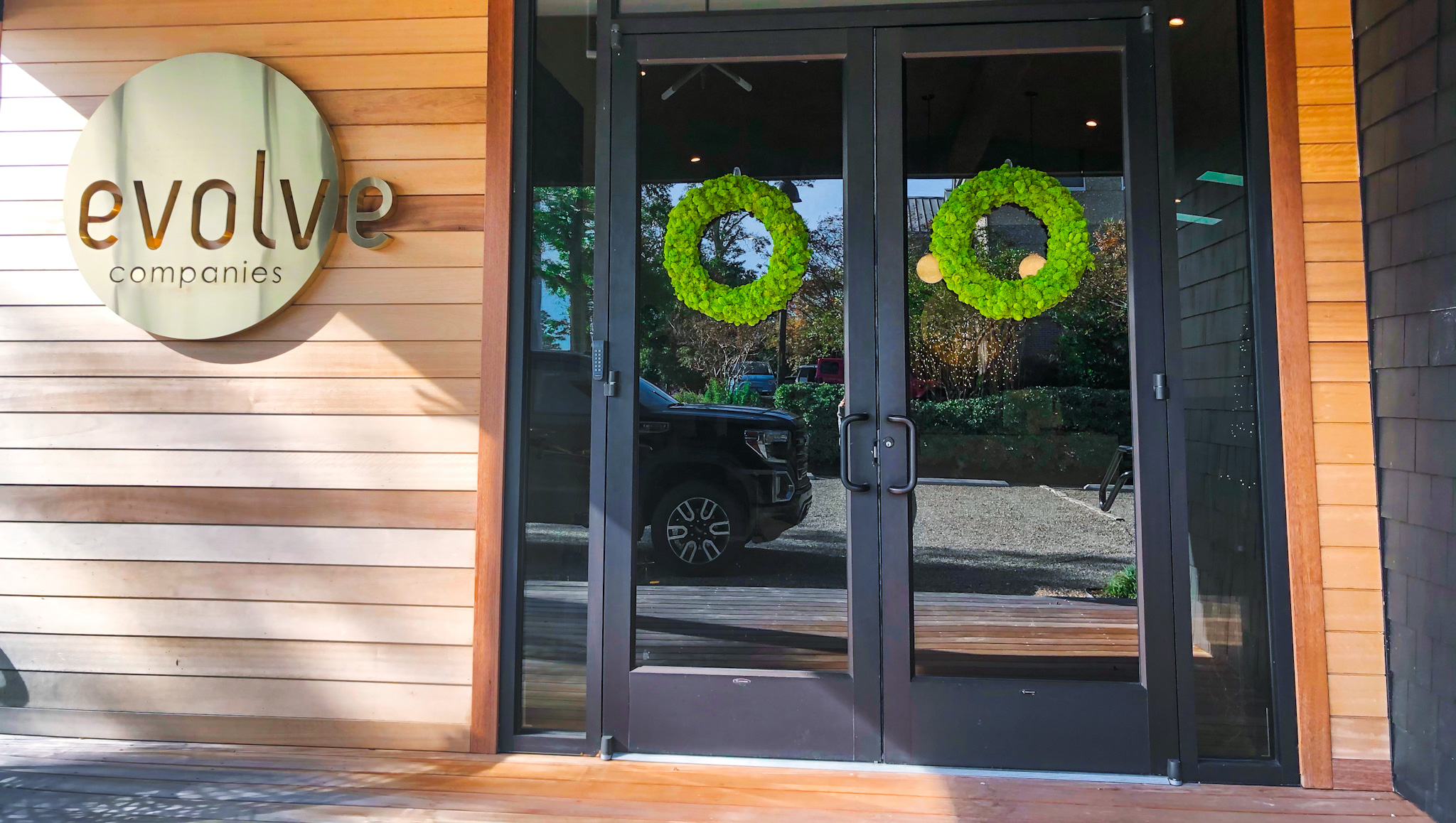 evolve doors with christmas wreaths